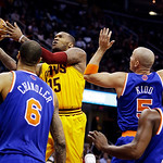 Cleveland Cavalier's Marreese Speights (15) jumps to the basket against New York Knicks' Tyson Chandler (6), Jason Kidd (5) and Raymond Felton (2) during an NBA basketball game, Monday, Marc …