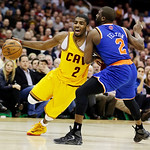 Cleveland Cavaliers' Kyrie Irving (2) is fouled by New York Knicks' Raymond Felton during the fourth quarter of an NBA basketball game, Monday, March 4, 2013, in Cleveland. The Knicks won 1 …