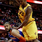 New York Knicks' Tyson Chandler, bottom, looks for help under pressure from Cleveland Cavaliers' Tristan Thompson during the first quarter of an NBA basketball game, Monday, March 4, 2013, i …