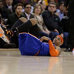 New York Knicks' Carmelo Anthony looks up after falling during the second quarter of an NBA basketball game against the Cleveland Cavaliers Monday, March 4, 2013, in Cleveland. (AP Photo/Ton …
