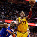 Cleveland Cavaliers' C.J. Miles (0) shoots around New York Knicks' Amare Stoudemire (1) during the fourth quarter of an NBA basketball game, Monday, March 4, 2013, in Cleveland. The Knicks w …