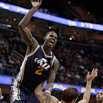Utah Jazz's Marvin Williams, left, jumps toward the basket against Cleveland Cavaliers' Luke Walton during the fourth quarter of an NBA basketball game Wednesday, March 6, 2013, in Cleveland …