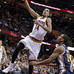 Cleveland Cavaliers' Shaun Livingston (14) shoots in front of Utah Jazz's Alec Burks (10) during the second quarter of an NBA basketball game Wednesday, March 6, 2013, in Cleveland. (AP Phot …