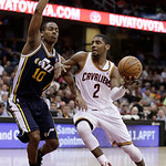 Cleveland Cavaliers' Kyrie Irving (2) drives against Utah Jazz's Alec Burks (10) during the fourth quarter of an NBA basketball game Wednesday, March 6, 2013, in Cleveland. The Cavaliers won …
