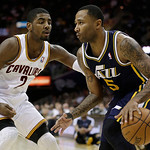 Utah Jazz's Mo Williams (5) works against Cleveland Cavaliers' Kyrie Irving (2) during the fourth quarter of an NBA basketball game Wednesday, March 6, 2013, in Cleveland. The Cavaliers won  …