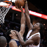 Cleveland Cavaliers' Tristan Thompson, right, jumps toward the basket under pressure from Utah Jazz's Enes Kanter, from Turkey, during the third quarter of an NBA basketball game Wednesday, …