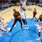Cleveland Cavaliers guard Kyrie Irving (2) shoots as Oklahoma City Thunder forward Serge Ibaka (9) defends during the fourth quarter of an NBA basketball game in Oklahoma City, Sunday, Nov.  …