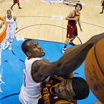 Oklahoma City Thunder forward Serge Ibaka (9) reaches in to block a shot by Cleveland Cavaliers forward Tristan Thompson, right, in the third quarter of an NBA basketball game in Oklahoma Ci …