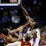 Oklahoma City Thunder center Kendrick Perkins, right, shoots over Cleveland Cavaliers forward Tristan Thompson, left, in the second quarter of an NBA basketball game in Oklahoma City, Sunday …