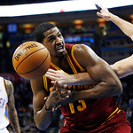 Oklahoma City Thunder forward Nick Collison, right, knocks the ball away from Cleveland Cavaliers forward Tristan Thompson (13) in the second quarter of an NBA basketball game in Oklahoma Ci …