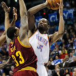 Oklahoma City Thunder forward Kevin Durant (35) shoots as Cleveland Cavaliers forward Alonzo Gee (33) defends in the fourth quarter of an NBA basketball game in Oklahoma City, Sunday, Nov. 1 …