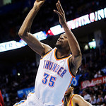 Oklahoma City Thunder forward Kevin Durant (35) shoots in front of Cleveland Cavaliers forward Tristan Thompson (13) in the third quarter of an NBA basketball game in Oklahoma City, Sunday,  …