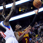 Philadelphia 76ers' Jrue Holiday (11) fouls Cleveland Cavaliers' Kyrie Irving (2) during the first half of an NBA basketball game on Sunday, Nov. 18, 2012, in Philadelphia. (AP Photo/Michael …