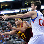 Cleveland Cavaliers' Anderson Varejao (17), of Brazil, passes the ball around Philadelphia 76ers' Spencer Hawes (00) during the first half of an NBA basketball game on Sunday, Nov. 18, 2012, …