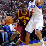 Cleveland Cavaliers' Dion Waiters (3) drives past Philadelphia 76ers' Evan Turner (12) during the first half of an NBA basketball game on Sunday, Nov. 18, 2012, in Philadelphia. (AP Photo/Mi …