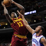 Cleveland Cavaliers' Tristan Thompson (13) shoots over Philadelphia 76ers' Evan Turner (12) during the first half of an NBA basketball game on Sunday, Nov. 18, 2012, in Philadelphia. (AP Pho …