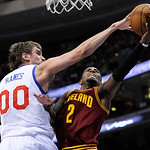 Philadelphia 76ers' Spencer Hawes (00) blocks a shot from Cleveland Cavaliers' Kyrie Irving (2) during the first half of an NBA basketball game on Sunday, Nov. 18, 2012, in Philadelphia. (AP …