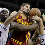 Cleveland Cavaliers' Omri Casspi, of Israel, center, and Memphis Grizzlies' Zach Randolph (50) battle for a rebound as Rudy Gay (22) participates during the second half of an NBA basketball  …