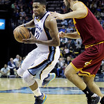 Memphis Grizzlies' Rudy Gay (22) is guarded by Cleveland Cavaliers' Omri Casspi, of Israel, right, during the second half of an NBA basketball game in Memphis, Tenn, Monday, Nov. 26, 2012. T …