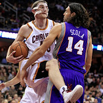 Cleveland Cavaliers' Tyler Zeller, left, gets a rebound ahead of Phoenix Suns' Luis Scola during the second quarter of an NBA basketball game Tuesday, Nov. 27, 2012, in Cleveland. (AP Photo/ …
