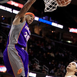 Phoenix Suns' Shannon Brown (26) dunks in front of Cleveland Cavaliers' Anderson Varejao during the first quarter in an NBA basketball game Tuesday, Nov. 27, 2012, in Cleveland. (AP Photo/To …