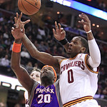Phoenix Suns' Jermaine O'Neal (20) and Cleveland Cavaliers' C.J. Miles (0) vie for a loose ball in the third quarter in an NBA basketball game Tuesday, Nov. 27, 2012, in Cleveland. The Suns  …