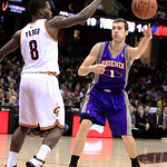 Phoenix Suns' Goran Dragic (1) passes around Cleveland Cavaliers' Jeremy Pargo (8) during the fourth quarter in an NBA basketball game Tuesday, Nov. 27, 2012, in Cleveland. The Suns won 91-7 …