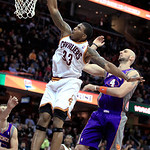 Cleveland Cavaliers' Alonzo Gee (33) dunks against Phoenix Suns' Marcin Gortat, right, during the second quarter of an NBA basketball game Tuesday, Nov. 27, 2012, in Cleveland. (AP Photo/Ton …