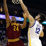Cleveland Cavaliers forward Samardo Samuels (24) shoots against Golden State Warriors center Andrew Bogut (12), from Australia, during the first quarter of an NBA basketball game in Oakland, …