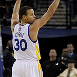 Golden State Warriors shooting guard Stephen Curry (30) celebrates after the Warriors scored a basket during the fourth quarter of an NBA basketball game against the Cleveland Cavaliers in O …