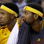 Cleveland Cavaliers shooting guard Daniel Gibson, left, and small forward C.J. Miles sit on the bench during the fourth quarter of an NBA basketball game against the Golden State Warriors in …