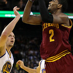Cleveland Cavaliers guard Kyrie Irving (2) shoots against Golden State Warriors forward David Lee during the second quarter of an NBA basketball game in Oakland, Calif., Wednesday, Nov. 7, 2 …