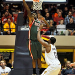 Milwaukee Bucks forward Larry Sanders, left, goes up for a dunk against Cleveland Cavaliers forward Tristan Thompson during the third quarter of a preseason NBA basketball game, Tuesday, Oct …