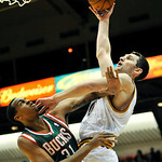 Cleveland Cavaliers forward Tyler Zeller, right, shoots over Milwaukee Bucks forward John Henson in the fourth quarter of a preseason NBA basketball game, Tuesday, Oct. 9, 2012, in Canton, O …