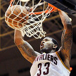 Cleveland Cavaliers guard Alonzo Gee dunks in the second quarter of a preseason NBA basketball game against the Milwaukee Bucks, Tuesday, Oct. 9, 2012, in Canton, Ohio. (AP Photo/David Richa …