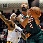 Milwaukee Bucks forward Drew Gooden (0) drives past Cleveland Cavaliers' Daniel Gibson during the second quarter of a preseason NBA basketball game, Tuesday, Oct. 9, 2012, in Canton, Ohio. ( …