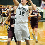 EC Riley Schill goes to hoop past Rocky River Annie Swartz in second half Jan. 9.  Steve Manheim