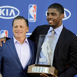 Cleveland Cavaliers' Kyrie Irving, right, poses with Cavaliers' owner Dan Gilbert after Irving was presented with the NBA Rookie of the Year award at the basketball team's headquarters in In …