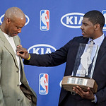 Cleveland Cavaliers' Kyrie Irving, right, jokes with head coach Byron Scott after Irving was presented with the NBA Rookie of the Year Award at the basketball team's headquarters in Independ …
