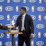 Cleveland Cavaliers' Kyrie Irving, right, is presented the  NBA Rookie of the Year award by Kia Motors America regional director Mike Helgesen at the basketball team's headquarters in Indepe …