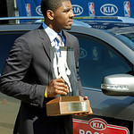Cleveland Cavaliers' Kyrie Irving carries the NBA Rookie of the Year trophy outside the basketball team's headquarters in Independence, Ohio Tuesday, May 15, 2012. (AP Photo/Mark Duncan)