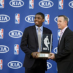 Cleveland Cavaliers' Kyrie Irving, left, poses with the NBA Rookie of the Year award with Kia Motors America regional director Mike Helgesen at the basketball team's headquarters in Independ …