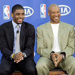 Cleveland Cavaliers' Kyrie Irving, left, laughs with head coach Byron Scott during a presentation of the NBA Rookie of the Year award to Irving at the basketball team's headquarters in Indep …
