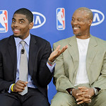 Cleveland Cavaliers' Kyrie Irving, left, jokes with head coach Byron Scott before Irving was presented with the NBA Rookie of the Year award at the basketball team's headquarters in Independ …