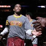 FILE – This March 18, 2012 file photo shows Cleveland Cavaliers Kyrie Irving heading to the court during team introductions before taking on the Atlanta Hawks in an NBA basketball game Cleve …