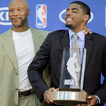 Cleveland Cavaliers' Kyrie Irving, right, clowns with head coach Byron Scott after Irving was presented the NBA Rookie of the Year award at the  Cavaliers' headquarters in Independence, Ohio …