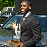 Cleveland Cavaliers' Kyrie Irving poses with his NBA Rookie of the Year trophy outside the basketball team's headquarters in Independence, Ohio Tuesday, May 15, 2012. (AP Photo/Mark Duncan)
