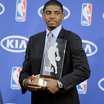 Cleveland Cavaliers' Kyrie Irving holds his NBA Rookie of the Year award at the basketball team's headquarters in Independence, Ohio Tuesday, May 15, 2012. (AP Photo/Mark Duncan)