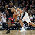 San Antonio guard Tony Parker, of France, drives against Miami Heat's LeBron James, left, during the second quarter of Game 5 in the NBA Finals in San Antonio on Sunday, June 16, 2013. The S …