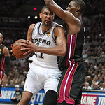 San Antonio forward Tim Duncan, left, goes to the basket against Miami Heat defender Chris Bosh during the fourth quarter of Game 5 in the NBA Finals in San Antonio on Sunday, June 16, 2013. …